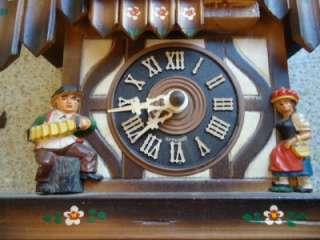 GERMAN CUCKOO CLOCK CARVED WOOD CASE MUSICAL CHIMES.