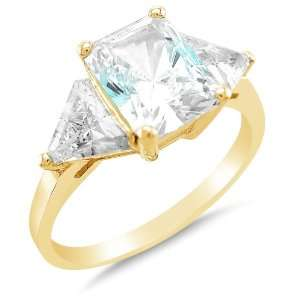 Gold 3 Three Stone Emerald Cut Solitaire with trillion Side Stones
